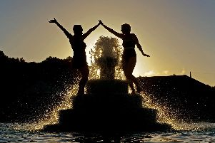Swimmers Joanne Crowther and Alla Horoshenkova at Ilkley Lido celebrate the summer soltice by having a dip at sunrise. Picture Tony Johnson.