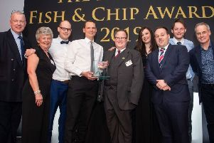 Trenchers on stage as they win Fish and Chip Restaurant of the Year.