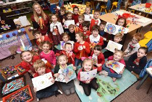 Airy Hill school celebrate Chinese New Year - class one with teacher Eve Locker. pic Richard Ponter