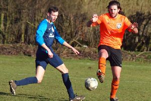 Snainton, orange kit, battle it out in their 5-0 home win against FC Rosette