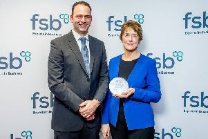 Stuart and Carol Fusco with the FSB award.