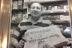 David behind the counter at his shop, Heaps of News, which he ran in Brierfield for 21 years.