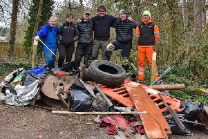 The Paddle Peak group with the haul of rubbish pulled from the River Derwent in Matlock Bath.