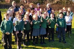 Airy Hill School children plant a mix of apple, pear, plum and cherry trees.