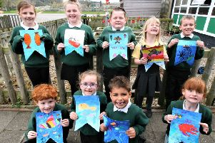 The children created more than 170 bunting flags with a ship on one side and a fish on the other for the festival.