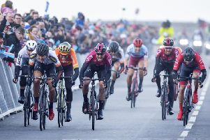Alexander Kamp, second left, takes the win from Chris Lawless of Team Ineos