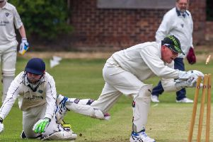 Staxtons wicket-keeper whips the bails off but Staithes batsman Steve Sargent dives in and makes his ground during his sides win in the Premier Division on Saturday ''''PICTURE BY BRIAN MURFIELD