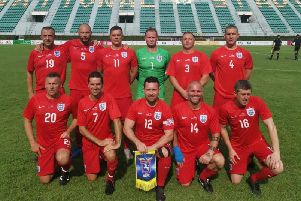 The Harrogate Veterans England Seniors team, captained by Jon Haigh (front, centre), line-up before their 1-1 draw with Hong Kong.