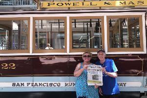 George and Glynis Cull of Whitby pictured with their Gazette by a San Francisco cable car.