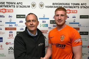 Vice-chairman Charlie Tolley (left) with new signing Tom Brennan (right).