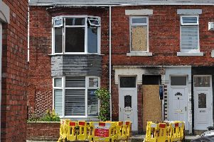 The flat has been boarded up since the blaze.