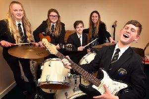 Caedmon College have been performing well with their music students...rocking out are..Lucy,Rebekah,Billy,Teacher Hannah Beattie and Fred  performing in their music booth.pic Richard Ponter