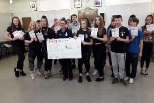 Youngsters receive a cheque for 1,000