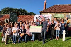 Eskuleles members present a cheque to the Great North Air Ambulance at the Fox and Hounds.