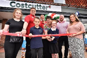 West Cliff teacher Victoria Lawn and pupils from West Cliff along with Costcutter staff at the re-opening of Whitby's Costcutter store.