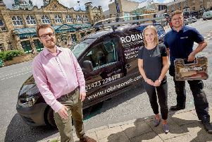 Success - Robinsons Facilities Services Luke Kitchen, managing director; Katie Challis, director; and Richard Parry, service engineer outside the Royal Hall and Harrogate Convention Centre.