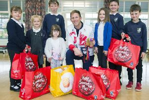 Opening of Aldi Store in Whitby by Olympic Rowing Champion Matthew Langridge.'Pictured at nearby East Whitby Primary Academy handing over products to (l-r) Lily Lawson, Millie Collier, Lila Austin , Brandon Anscombe, Roxi Fenwick, Jack McLoughlin, Dylan Eglon. 'Note: All have permission to be photographed.''Picture: Sean Spencer