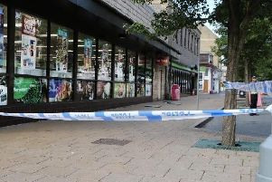 Police have cordoned off Spring Gardens in Buxton after an assault.