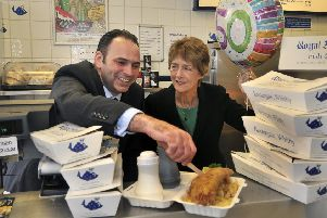 Royal Fisheries Fusco ltd in Whitby, celebrate their 50th anniversary . Stuart Fusco and Mum Karen Fusco celebrate  some fish and chips .pic Richard Ponter 182125e
