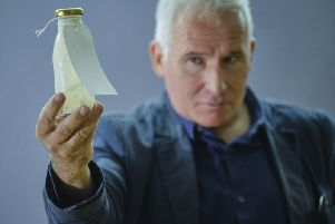 Simon Hedges with one of the bottles used in the installation at Scarborough Art Gallery