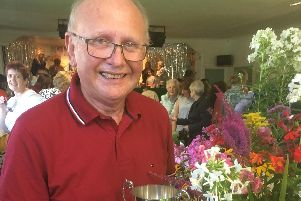 Gardener Keith Pedder with his special trophy in the floral section