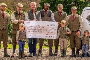 Jimmy Shuttlewood (far right) with a group of keepers and next generation gamekeepers, Jimmys young sons Arthur, Oscar and Rupert, handing over a cheque to the Yorkshire Air Ambulance for 3,333.33.