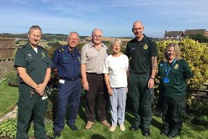 Tony and wife Janet (central) are reunited with left to right: Senior Paramedic Team Leader Damian Walsh, Community First Responder Peter Gregory, Paramedic Mark Jackson and Emergency Medical Dispatcher Shelley Buckley