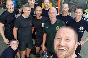 Matthew (front) with firefighters and paramedics on day 999 of his epic running stint