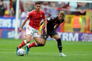 Liam Cooper in action for Leeds United at Charlton, up against Josh Cullen. Picture: Tony Johnson