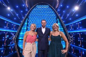 Sisters Helen McDonald and Louise Seymour, from Leeds, with The Wall host Danny Dyer. Credit: BBC.
