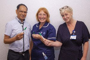 Staff at the borough's hospital Trust are urging Wiganers to get flu jabs