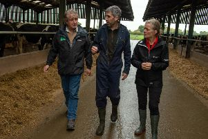 Natural England chair Tony Juniper (left) and Environment Agency chair Emma Howard Boyd (right) were shown around South Acre Farm near York by farmer Paul Tompkins (centre) who has reduced water pollution from his dairy herd with the help of the Government's Catchment Sensitive Farming service. Picture by Bruce Rollinson.