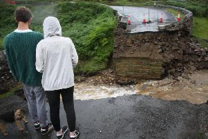The collapsed bridge following heavy rainfall on Grinton moors, North Yorkshire. Pics: SWNS