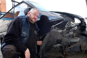 Karl Chadwick with his written-off vehicle