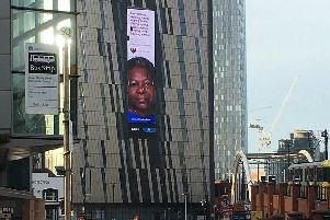 Geneva Rhodes appears on a large advert on the Axis Tower