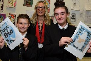 Head of art Penny Walmsley, centre, with year seven pupils, George, 11, and Sian, 11, at Bedford High School, Leigh, with their artwork