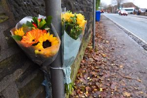 Flowers at the scene of the collision which claimed Donna Barrow-Jones's life on Wigan Lane