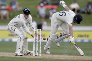 Can't get me out: New Zealand's Tom Latham, left, looks to catch the ball as England's Joe Root runs to make his ground during play on day four of the second cricket test between England and New Zealand at Seddon Park (AP Photo/Mark Baker)