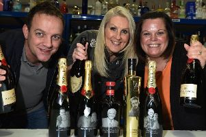 Andi Briggs, Lorraine Briggs and Keeley Latchford at Prestige Drinks with the personalised bottles chosen as the best Christmas gift on TV show Top Pick