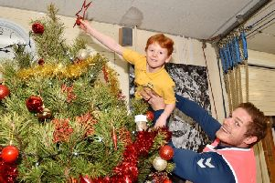 George Burgess helps put a star on the tree!