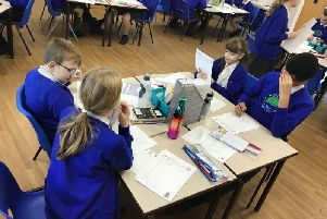 Year six pupils working out the cost of their Christmas dinner