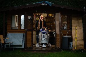 Film buff Ricky Butler with his R2-D2