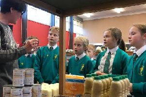 Pupils brought donated food to the charity