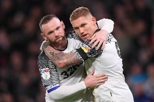 Wayne Rooney of Derby County speaks to Martyn Waghorn of Derby County during the Sky Bet Championship match between Derby County and Barnsley at Pride Park Stadium.