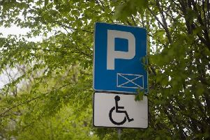 Blue Badges are issued by councils to people with disabilities and allow them to park closer to their destination