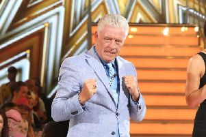 Derek Acorah leaves the house after being evicted during the Celebrity Big Brother Final (Tim P. Whitby/Getty Images)