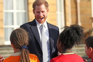 Prince Harry watched children play rugby league at Buckingham Palace ahead of the World Cup draw