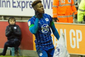 Jamal Lowe wheels away in delight after scoring the winner
