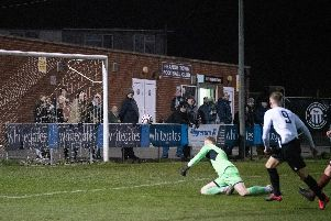 Jamie Sleigh finishes neatly for Heanor Town against Radford on Wednesday night