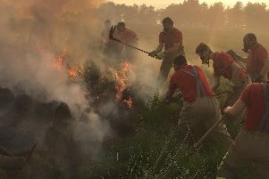 Firefighters tackle the fire at Winter Hill